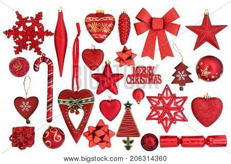 Red christmas bauble decorations and symbols on white background.