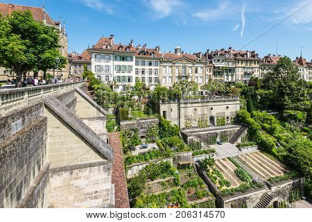 Bern Switzerland - May 26 2016: Upscale residential area with terraced gardens near the Bern Cathedral and Aare River. People on the Minster Terrace.