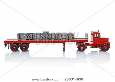 A toy truck with the words Leasing and Finance on the back made for old letterpress blocks. Isolated on a white background.