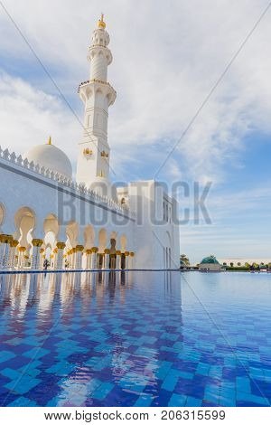 ABU DHABI, UAE - JAN 18, 2017: White Sheikh Zayed Mosque is one of six largest mosques in world, mosque was officially opened in 2007