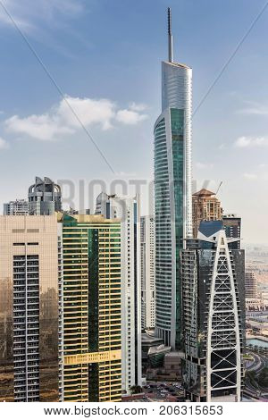 DUBAI, UAE - JAN 13, 2017: Almas Tower, Indigo Tower, Lake City Tower, Global Lake View, highway, Every year more than 55 million tourists visit Dubai