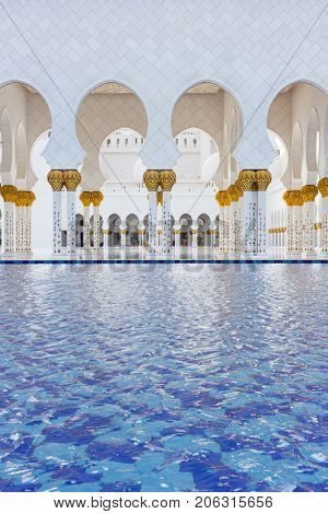 ABU DHABI, UAE - JAN 18, 2017: Arches in Sheikh Zayed Mosque is one of six largest mosques in world, mosque was officially opened in 2007