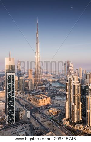 DUBAI, UAE - JAN 9, 2017: Evening Millenium Tower and Burj Khalifa, Executive Towers, Burj Khalifa - skyscraper in height of 828 meters in Dubai, tallest structure in world
