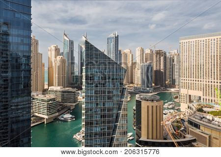 DUBAI, UAE - JAN 13, 2017: Silverene Tower RMJM, Marina Canal in Marina area, Designed by RMJM, this complex offers 35 floors in Tower A and 26 floors in Tower B