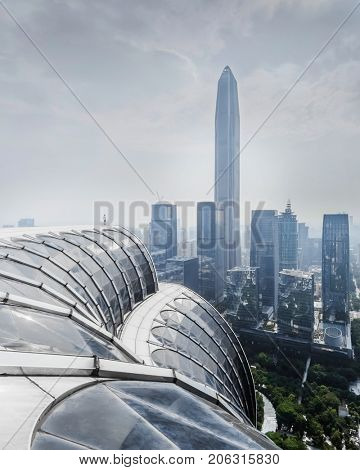 CHINA, SHENZHEN - AUG 27, 2015: Cityscape, man of roof, view from Futian Road, According to UN, Shenzhen (with 10 million people) is among top five cities in world in terms of population growth rate