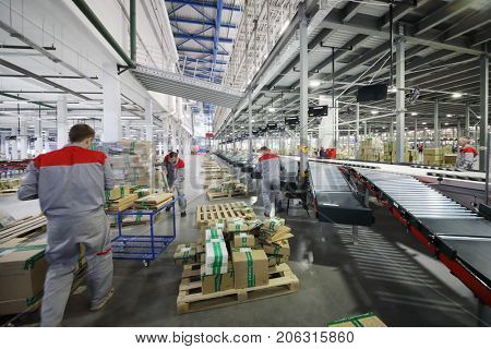 TVER, RUSSIA - MAY 17, 2017: People work in warehouse and sorting center of Ozon internet shop, it takes sixth place in list of most expensive russian internet companies