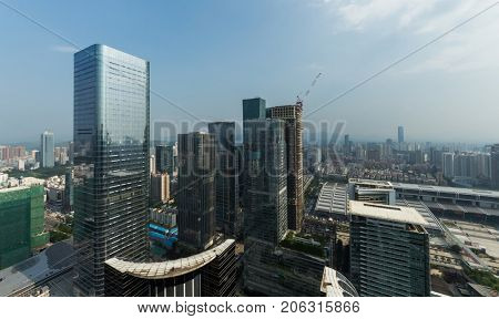 CHINA, SHENZHEN - AUG 27, 2015: City skyscrapers, view from Futian Road, According to UN, Shenzhen (with 10 million people) is among top five cities in world in terms of population growth rate