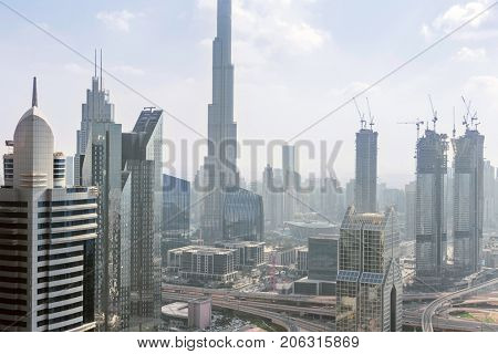 DUBAI, UAE - JAN 8, 2017: Dusit Thani Dubai Hotel, Burj Khalifa, Central Park Residential Tower, Dubai ranked fifth in Emporis ranking of world cities with largest number of skyscrapers
