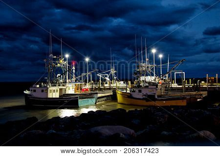 Fishing boats in the bay of Fundy in New Brunswick during the night