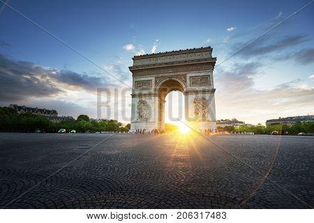 Arc de Triomphe (Triumphal Arch) at sunset; Paris; France