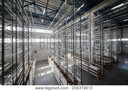 Modern warehouse with many shelves - long hallway in sorting center