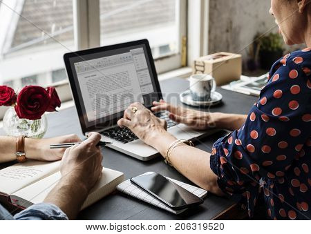 Woman Working on Laptop Typing Essay Information