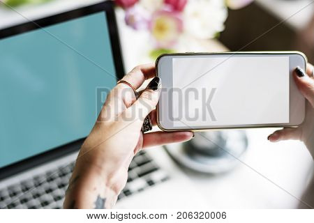 Woman Hands Using Mobile Phone Capture Photo with Laptop Background