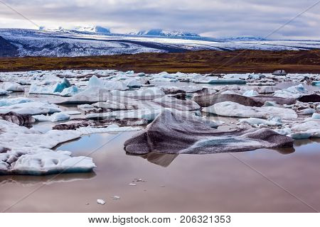 The grand spectacle -  the glacier Vatnajokull, Iceland's largest glacier. Glacier provides water Ice Lagoon Jokulsarlon. The concept of extreme northern tourism