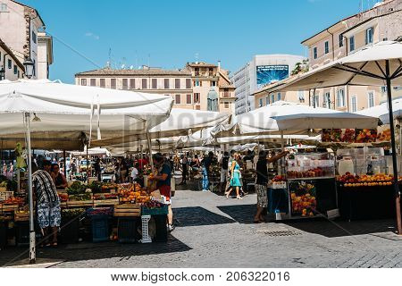 Rome Italy - August 22 2016: Street market with fruits in Campo di Fiori square in Rome.