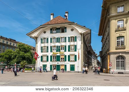 Bern Switzerland - May 26 2016: The famous Entrecote Cafe Federal houses in traditional Swiss building in Bundesplatz square in Bern Switzerland.