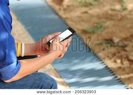 Close up hands of teenager using mobile smart phone. Social ignore crisis concept