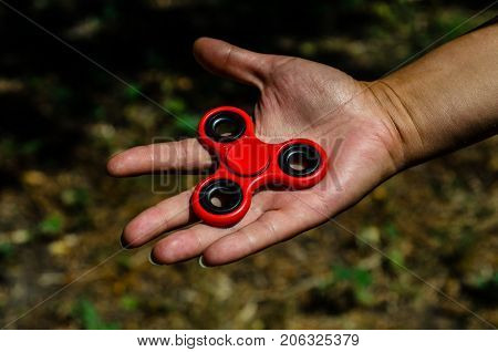 Red Fidget Spinner In Female Hand