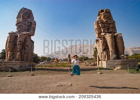 Fun near the beautiful ruins of ancient statues in Luxor, Egypt