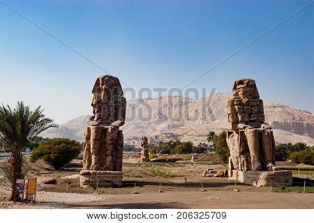 The ruins of ancient statues in Luxor, Egypt