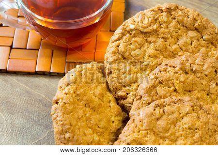 Fresh oatmeal cookies. Delicious and healthy Breakfast. Invigorating hot tea with fresh lemon.