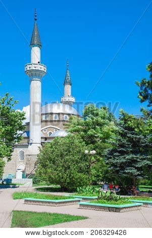 Yevpatoriya Crimea mosque Han-Jami, against the background of trees and sky