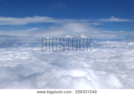 Unreal fantastic landscape - flying above the clouds