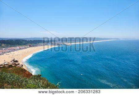 Bird's-eye View On Nazare Beach Riviera On The Coast Of Atlantic Ocean With Nazare Town