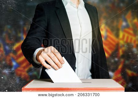 Man Voter Putting A Ballot Into A Voting box. Democracy Freedom Concept