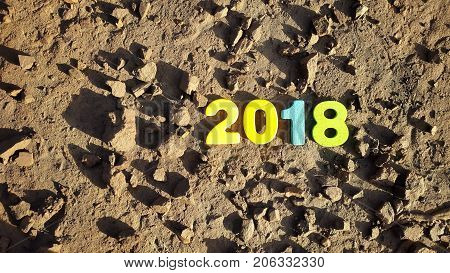 colored figures to form the number 2018 on the lunar surface.