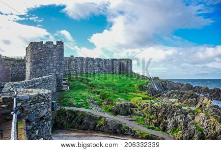 Beautiful coast of the Isle of Man from Peel Hill with great wall of Peel Castle constructed by viking in Peel city, Isle of Man