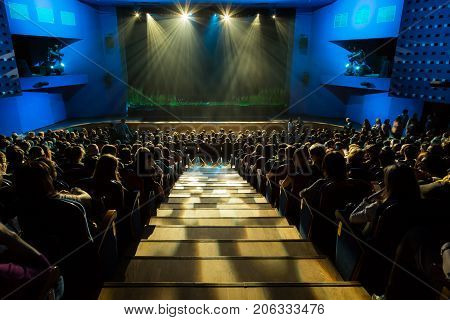 The stage before the show. The audience in the hall. The spotlight on stage. Theatre of the young spectator. Russia, Saratov, 7 March 2017