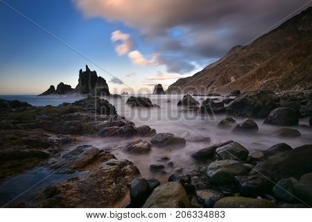view of wild Benijo beach with big waves and black sand on the north coast of the Tenerife island, Spain - long exposure image