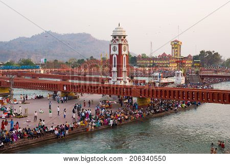 Holy Ghats And Temples At Haridwar, India, Sacred Town For Hindu Religion. Pilgrims Praying And Bath