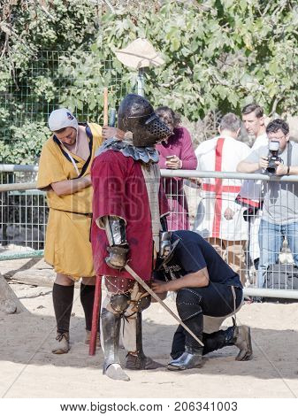 Jerusalem Israel September 23 2017 : Repair of armor on a knight in a break between fights at the festival