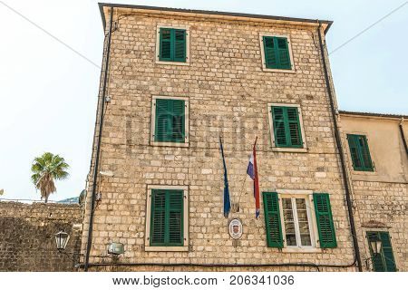 Kotor, Montenegro - August 24, 2017: Fragment  of the building of the old town of Kotor, Montenegro. The Old Town of Kotor is a UNESCO World Heritage site and a famous tourist attraction.