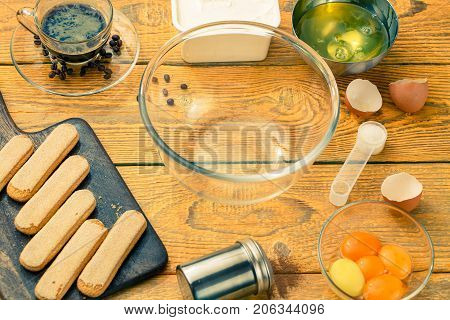 Photo savoyardi cookies on cutting board, cups, coffee, cream cheese, yolks and squirrels