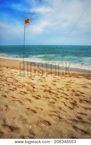 Beautiful Sri Lanka landscape.Beach and tropical sea. Paradise idyllic beach Sri Lanka. Exotic water landscape with clouds on horizon. Summer holidays. Ocean shore in the evening as nature travel background.