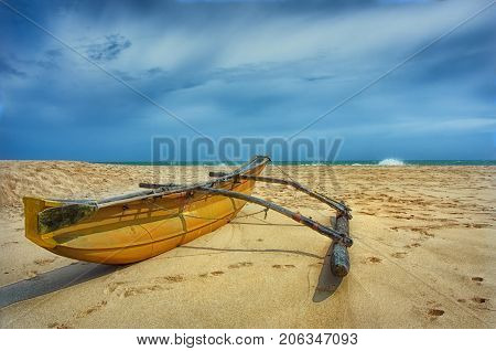 Fishing boat.Beach and tropical sea. Paradise idyllic beach Sri Lanka. Beautiful Sri Lanka landscape. Exotic water landscape with clouds on horizon. Summer holidays. Ocean shore in the evening as nature travel background.