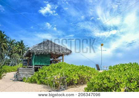 Beach and tropical sea. Paradise idyllic beach Sri Lanka. Beautiful Sri Lanka landscape. Exotic water landscape with clouds on horizon. Summer holidays. Ocean shore in the evening as nature travel background.