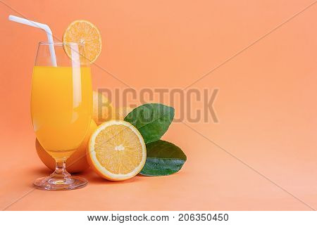 Orange juice in glass and fresh citrus around on wooden table background fruit product display or montage