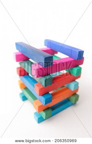 Close up photo of hight colorful chalks tower, isolated on white background