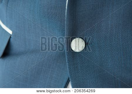 button of blue business man formal suit