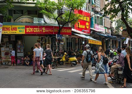 Hanoi Street With With Tourists And Locals