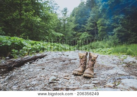 Leather Hiking Boots In Forest. Adventure, Traveling, Lifestyle.
