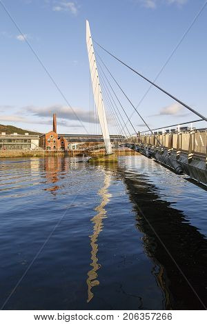 Swansea, UK: February 08, 2017: The Millennium footbridge over the River Tawe at the new Marina development in Swansea's docklands area.