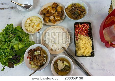 Ban cha meal set. Traditional Vietnamese ban cha meal set with meat noodles and springrolls served with fresh chili ginger and herbs