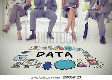 Data text surrounded by various icons against business people sitting on chairs