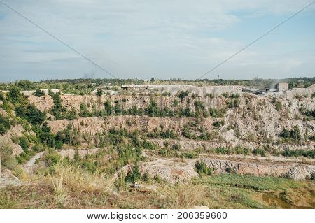 Stone quarry with excavate - Open pit mine.