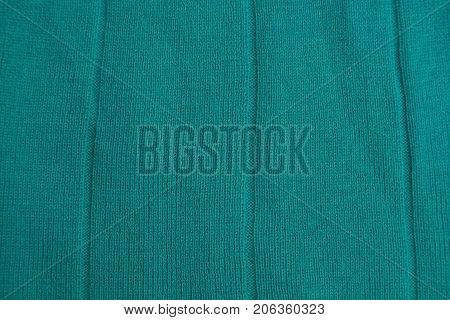 Texture of a green cloth from a piece of cloth